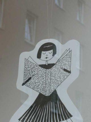 Zeichnung einer lesenden Frau